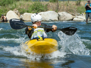 CASCADE, IDAHO/USA - JUNE 21, 2014: Kayaker 23 working his way through the river at the Payette River Games in Cascade, Idaho - Shot Your show