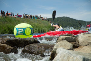 CASCADE, IDAHO/USA - JUNE 21, 2014: Kayaker gets around the number 2 bouy without getting into the rocks at the Payette River Games - Shot Your show