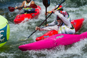 CASCADE, IDAHO/USA - JUNE 21, 2014: Kayaker pushes his way in front during the Payette River Games - Shot Your show