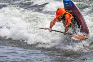 CASCADE, IDAHO/USA - JUNE 21, 2014: Kayaker tries a flip at the Payette River Games - Shot Your show