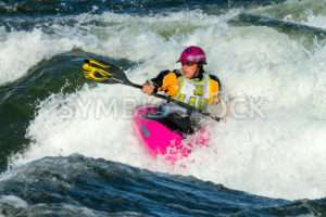 CASCADE, IDAHO/USA - JUNE 21, 2014: Kayaker watching the water to plan her next trick at the Payette River Games - Shot Your show