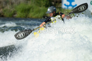 CASCADE, IDAHO/USA - JUNE 21, 2014: Kayaker working the wave at the Payette River Games - Shot Your show