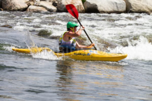 CASCADE, IDAHO/USA - JUNE 21, 2014: Man kayaking down the river at the Payette River Games in Cascade, Idaho - Shot Your show