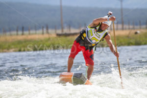 CASCADE, IDAHO/USA - JUNE 21, 2014: Man paddles his board as fast as he can going for the win at the Payette River Games in Cascade, Idaho - Shot Your show