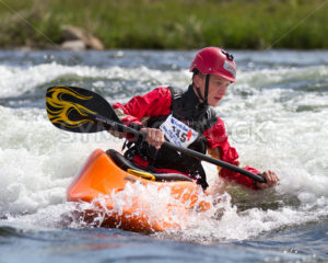 CASCADE, IDAHO/USA - JUNE 21, 2014: Number 115 works the wave action at the Payette River Games - Shot Your show