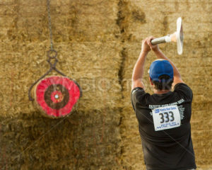 CASCADE, IDAHO/USA - JUNE 21, 2014: Number 333 tries to hit a target with his axe at the Payette River Games - Shot Your show