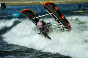 CASCADE, IDAHO/USA - JUNE 21, 2014: Rafter at the Payette River Games gets stuck in a wave and topples over. - Shot Your show