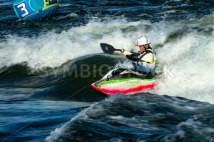 CASCADE, IDAHO/USA - JUNE 21, 2014: Slower shutterspeed image of a woman going for points during the Payette River Games in Cascade, Idaho - Shot Your show