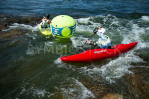 CASCADE, IDAHO/USA - JUNE 21, 2014: Two people are passing the number 2 bouy at the Payette River Games - Shot Your show