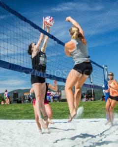 CASCADE, IDAHO/USA - JUNE 21, 2014: Two people jump at the net to make a play at the Payette River Games - Shot Your show