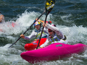 CASCADE, IDAHO/USA - JUNE 21, 2014: Two people racing their kayaks at the Payette River Games in Cascade, Idaho - Shot Your show