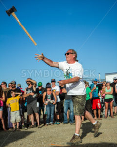 CASCADE, IDAHO/USA - JUNE 21, 2014: Unidentified man throwing an axe at a target at the Payette River Games - Shot Your show