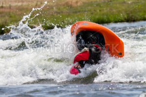 CASCADE, IDAHO/USA - JUNE 21, 2014: Unidentified person working a trick during the Payette River Games - Shot Your show