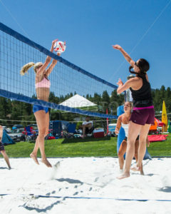 CASCADE, IDAHO/USA - JUNE 21, 2014: Unidentified woman blocks the ball at the Payette River Games - Shot Your show