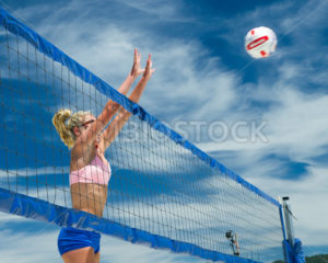CASCADE, IDAHO/USA - JUNE 21, 2014: Unidentified woman jumps at the net to block at the Payette River Games in Cascade, Idaho - Shot Your show