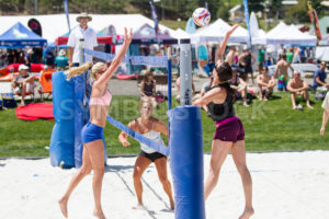 CASCADE, IDAHO/USA - JUNE 21, 2014: Unidentified woman spikes the ball at the other team during the Payette River Games - Shot Your show