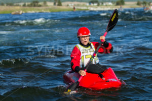 CASCADE, IDAHO/USA - JUNE 21, 2014: Waiting for her turn to go down the river a Kayaker relaxes in the water at the Payette River Games in Cascade, Idaho - Shot Your show