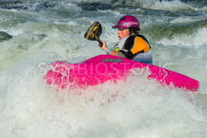 CASCADE, IDAHO/USA - JUNE 21, 2014: White water foaming this person stays up at the Payette River Games in Cascade, Idaho - Shot Your show