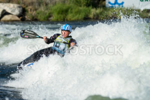 CASCADE, IDAHO/USA - JUNE 21, 2014: Woman working in the water trying to score points at the Payette River Games in Cascade, Idaho - Shot Your show