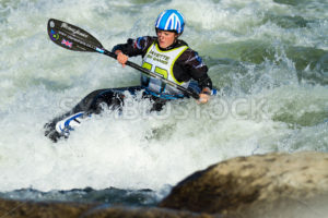 CASCADE, IDAHO/USA - JUNE 21, 2014: Woman works her way through the rapid at the Payette River Games in Cascade, Idaho - Shot Your show