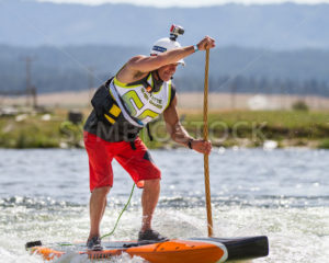 CASCADE, IDAHO/USA - JUNE 21, 2014: Working it for the finish line on a stand up paddle board at the PAyette River Games - Shot Your show