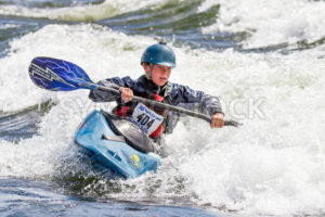 CASCADE, IDAHO/USA - JUNE 21, 2014: Young Person trying to win a the Payette River Games in Cascade, Idaho - Shot Your show