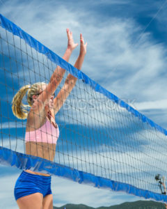CASCADE, IDAHO/USA - JUNE 21, 2014:Woman jumps up to try to block the shot at the Payette River Games in Cascade, Idaho - Shot Your show