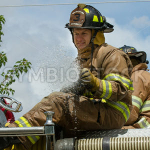 EAGLE/IDAHO – JUNE 9: Fireman on top of his firetruck after he just opened his firehose during the Eagle Fun days in Eagle, Idaho on June 9th, 2012 - Shot Your show