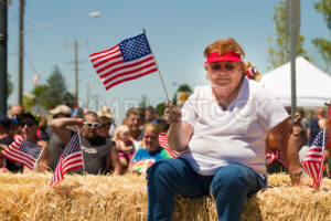 MIDDLETON, IDAHO – JULY 4: Lavena Gardner waving an american flag during the fourth of july parade of 2012 in Middleton, Idaho - Shot Your show