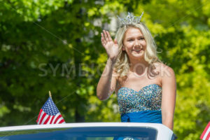 Woman waves at the parade - Shot Your show