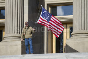 man holding a flag - Shot Your show