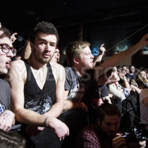 BOISE, IDAHO – FEBRUARY 15, 2015: A member of the crowd stops for a moment to stare back at the camera - Shot Your show