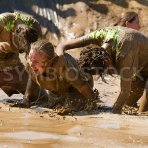 BOISE, IDAHO – AUGUST 25: Group of peoplehorsing around in the mud at the Dirty Dash August 25 2012 in Boise, Idaho - Shot Your show