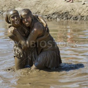 BOISE, IDAHO/USA – AUGUST 11, 2013: big smiles teamates pose together at The Dirty Dash in Boise, Idaho - Shot Your show